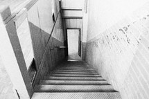 An old steep, narrow stairway.