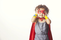Child dressed as a superhero.
