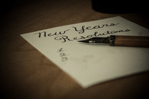 New Years resolution list and pen on a table.