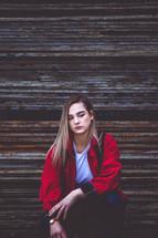 teen girl in a red coat