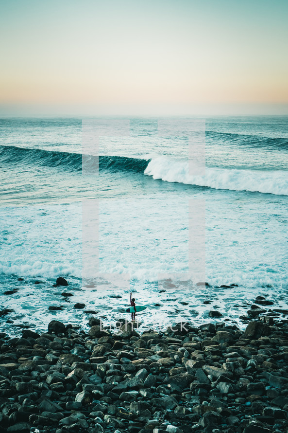 surfer standing on a shore