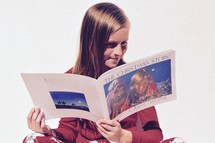 a child reading a children's book about the birth of Christ