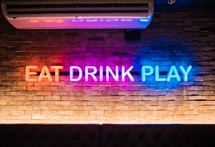 Eat, Drink, Play neon sign