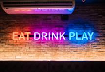 Eat, drink, play neon sign — Photo — Lightstock