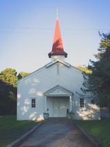 steeple on a rural white church
