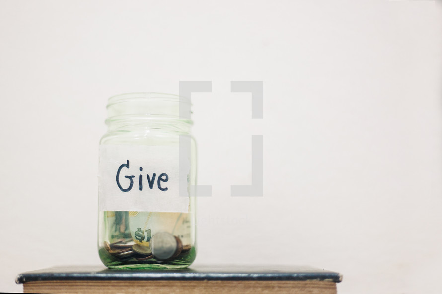 giving jar on a Bible