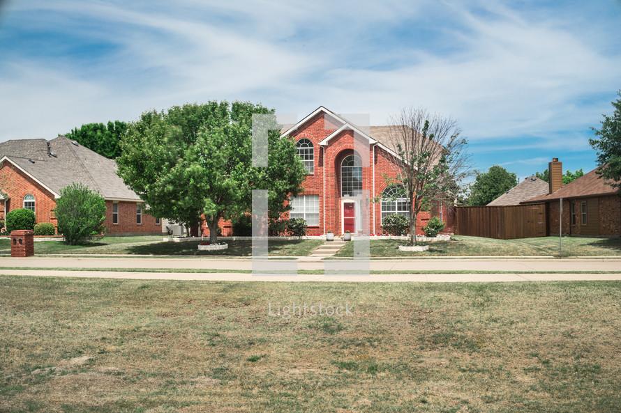 brick house in a neighborhood
