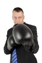 a businessman wearing boxing gloves