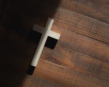 cross on a wood floor
