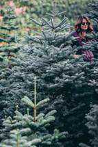 woman at a Christmas tree farm