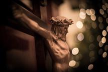 crucifix and bokeh Christmas lights