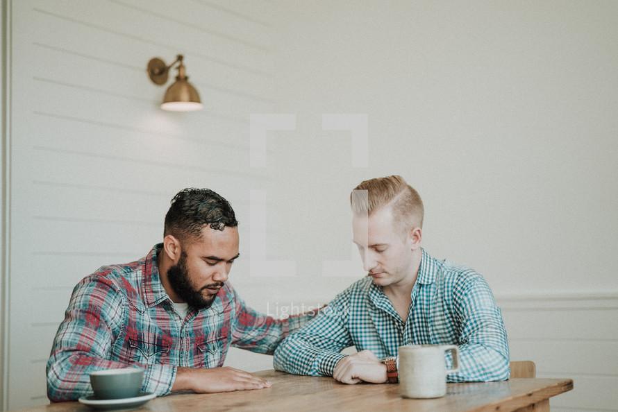 two men praying together