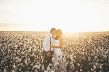 A bride and groom in a field of cotton
