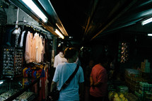 people shopping in a dark market