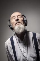 elderly man listening to headphones