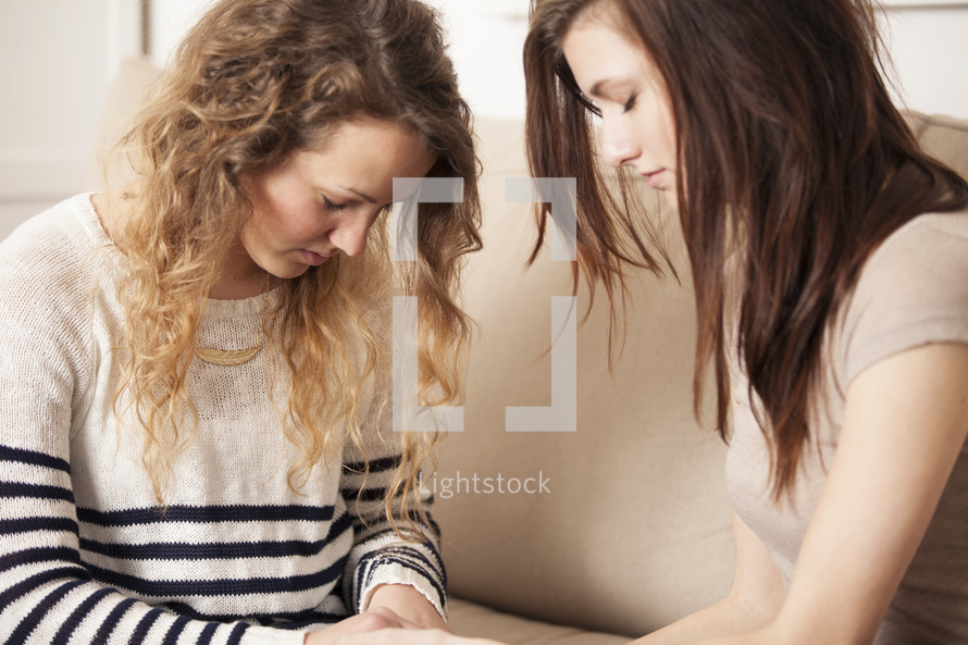 Friends praying together.