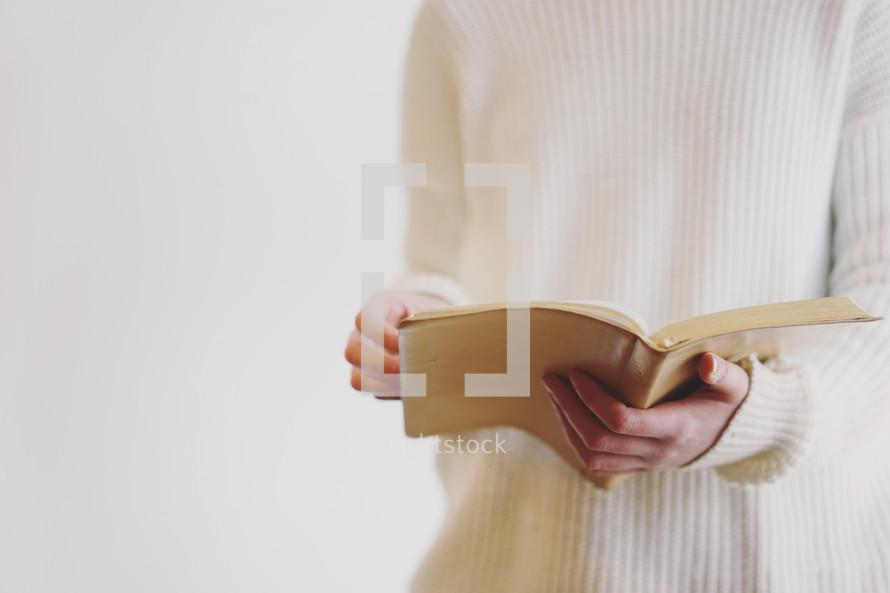 a woman reading a Bible