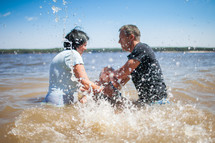 a child's baptism in water outdoors