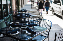 outdoor reserved table along a city sidewalk