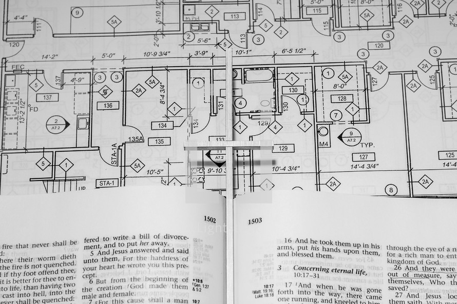 blueprints and an open Bible