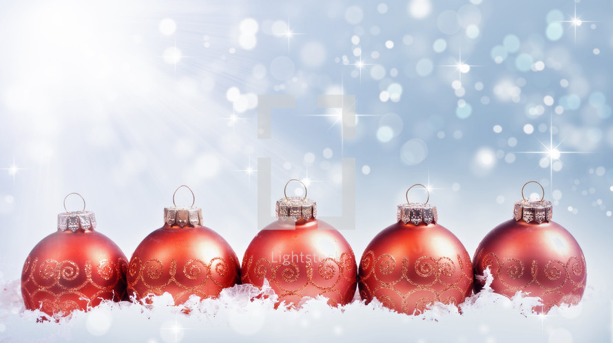 Christmas Bulbs.Row Of Red Christmas Bulb Ornaments In Snow Photo Lightstock
