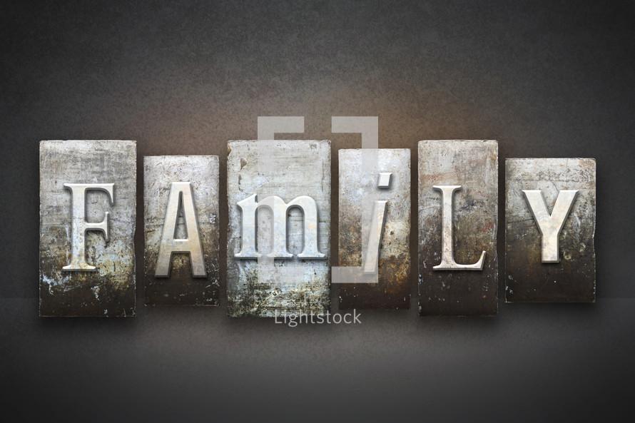 Stone tiles spelling the word Family.