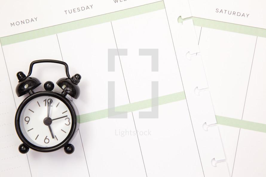 alarm clock on a calendar