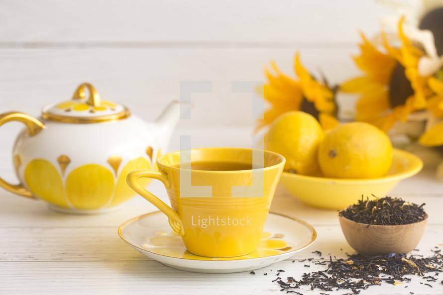 Bright Yellow Tea Set on a White Wood Table