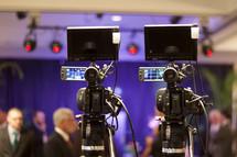 cameras recording a banquet