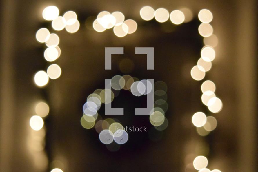 bokeh white Christmas lights garland and wreath