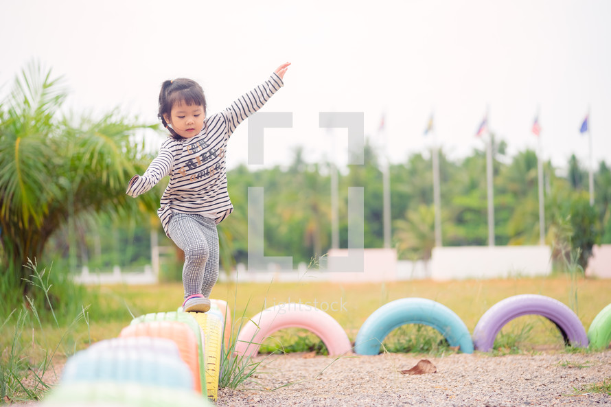 a toddler on a playground