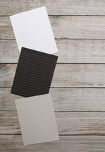 different colored paper on wood background
