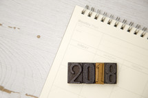 wood stamps 2018 on a calendar