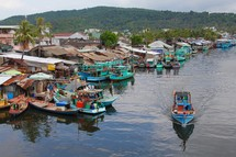 boats on a channel in a fishing village