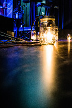 lightbulb in a jar on a stage