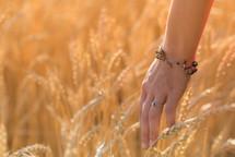 woman touching wheat grains