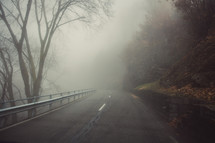 cars driving on a foggy highway