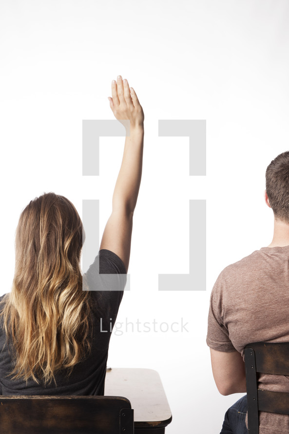 student with her hand raised