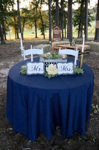 Mr and Mrs table at a wedding reception