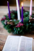 open Bible and Advent wreath
