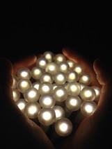 hands holding balls of light