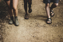 feet walking on a dirt path