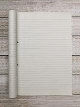 paper in a notebook