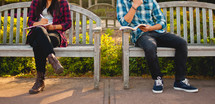 teens studying on benches