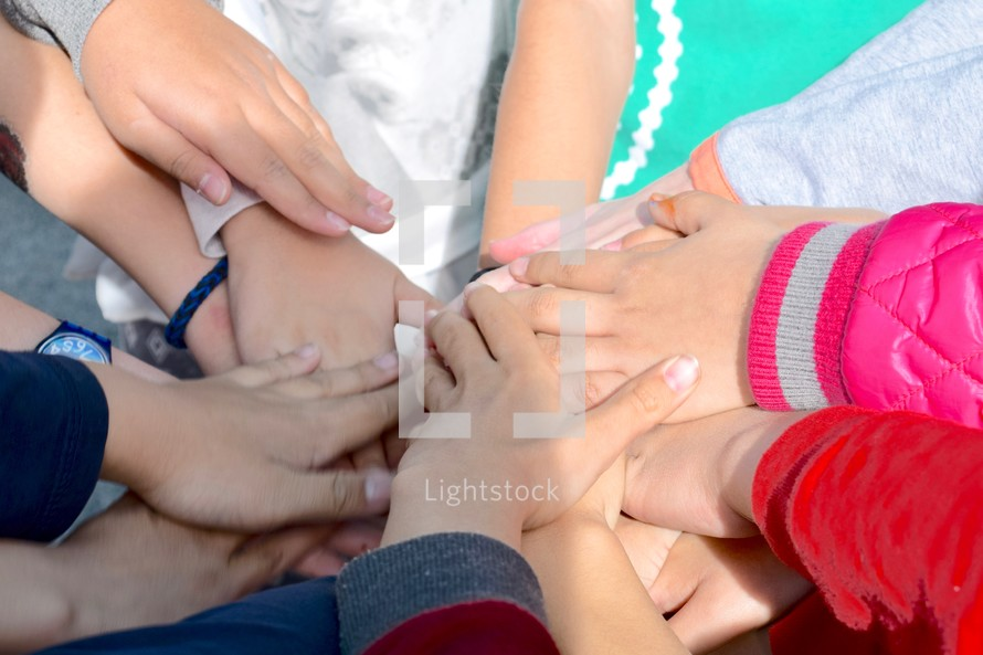 kids with stacked hands for teamwork