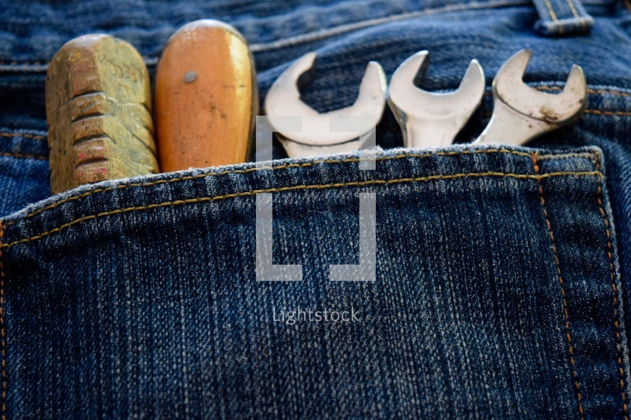 tools in a jeans pocket