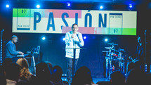 worship leader on stage holding a microphone
