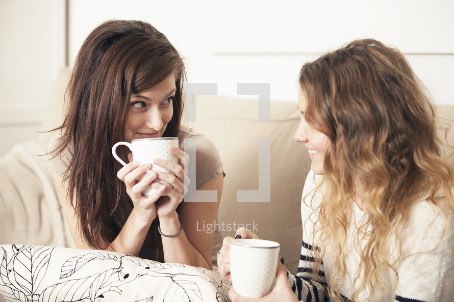 Friends talking over coffee.