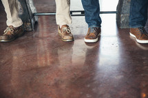 men's feet on a stained concrete floor