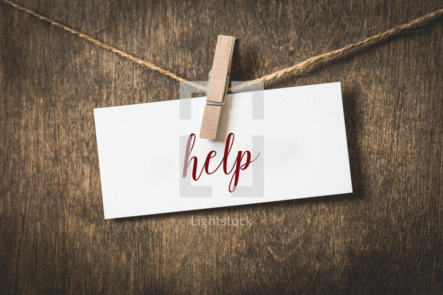 word help on card stock hanging on twine by a clothespin